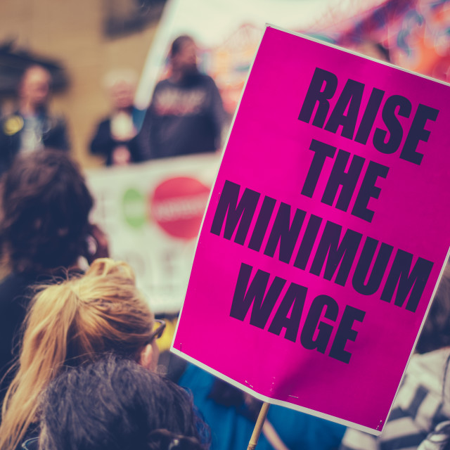 """Raise The Minimum Wage Protest SIgn"" stock image"