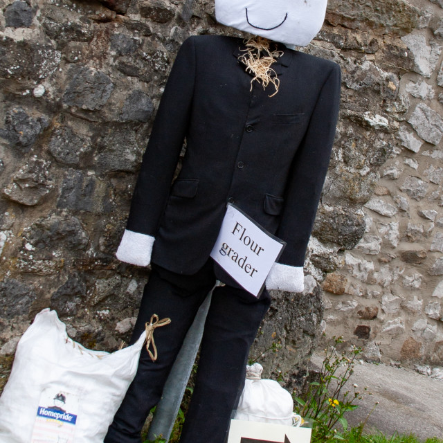 """""""Kettlewell Scarecrow Festival and Trail, Flour Grader. Yorkshire Dales, England."""" stock image"""