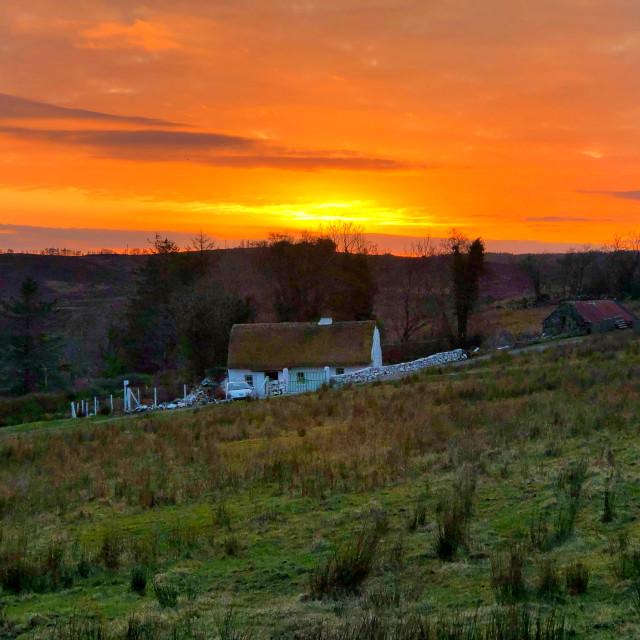 """Irish Cottage in the sunset"" stock image"