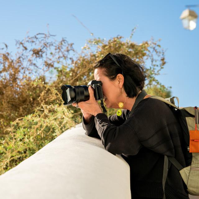 """Woman taking photo"" stock image"