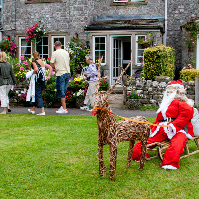 """""""Kettlewell Scarecrow Festival and Trail, Santa on Sleigh. Yorkshire Dales, England."""" stock image"""