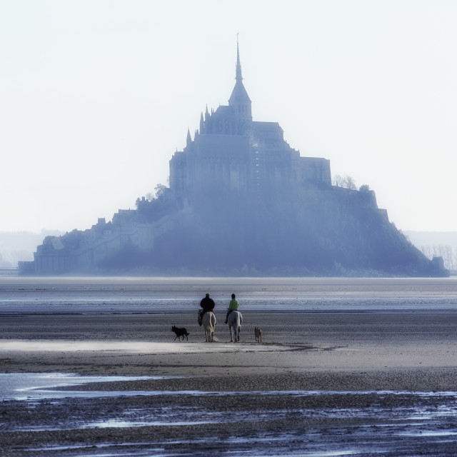 """Horse riders in the Mont-Saint-Michel bay"" stock image"