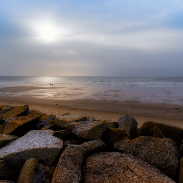 """Foggy sunset in Hauteville-sur-Mer beach"" stock image"