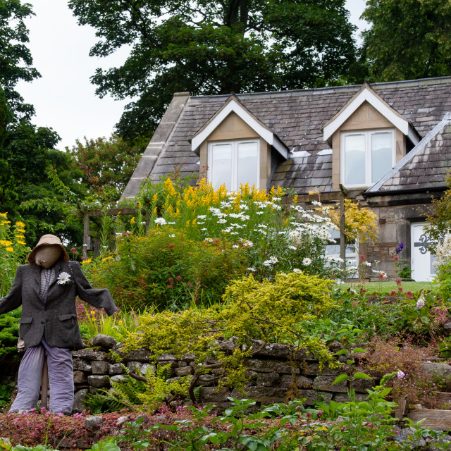 """""""Kettlewell Scarecrow Festival and Trail, Country Garden. Yorkshire Dales, England."""" stock image"""