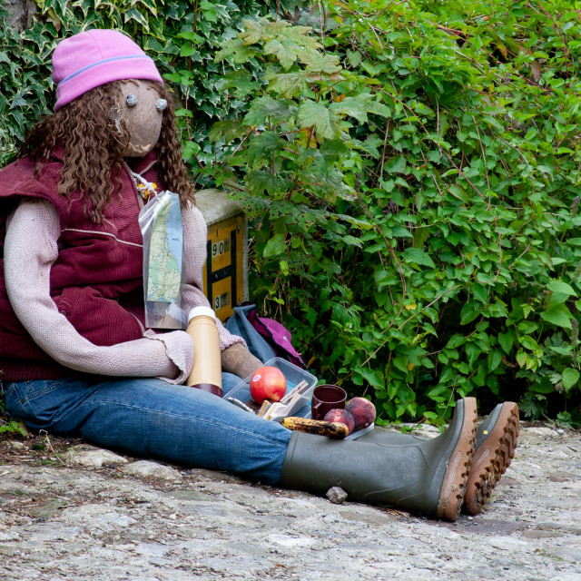 """""""Kettlewell Scarecrow Festival and Trail, Hiker at Lunchbreak. Yorkshire Dales, England."""" stock image"""