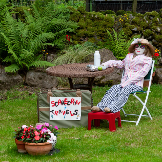 """""""Kettlewell Scarecrow Festival and Trail, Traveller taking a Break. Yorkshire Dales, England."""" stock image"""