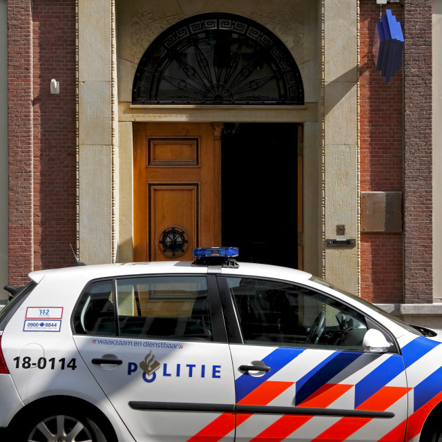 """""""Dutch police car parked outside a police station"""" stock image"""