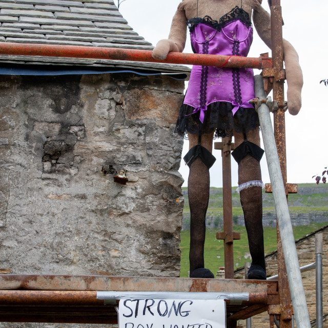 """""""Kettlewell Scarecrow Festival and Trail, Lady Builder on Scaffolding. Yorkshire Dales, England."""" stock image"""