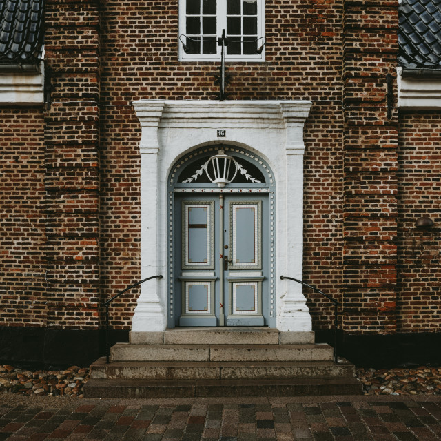 """The front view of a old brick house in the oldest Denmark town Ribe"" stock image"