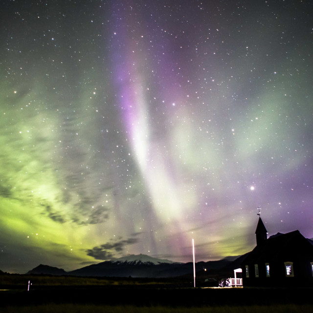"""""""Angelic Form in Purple and Green Aurora borealis over Budir Church Iceland"""" stock image"""