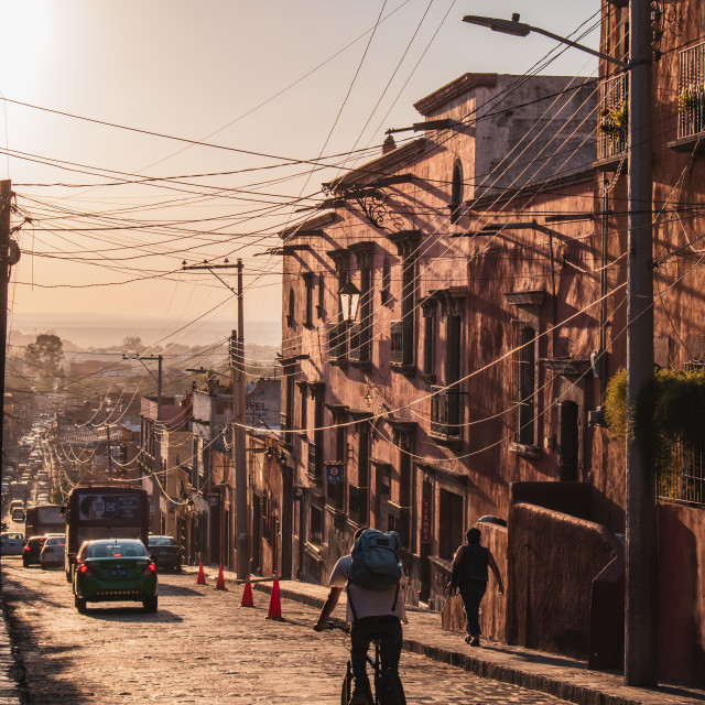"""A Cyclist at Golden Hour in San Miguel de Allende, Mexico"" stock image"