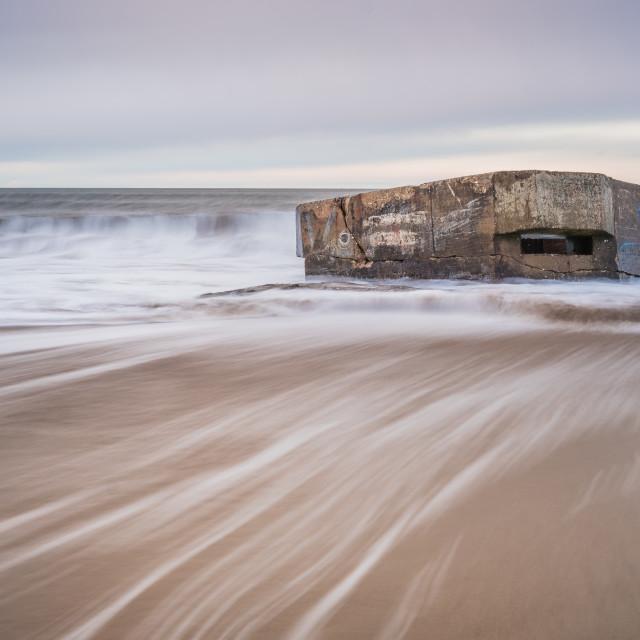 """Receding tide at the pillbox, Cayton Bay"" stock image"