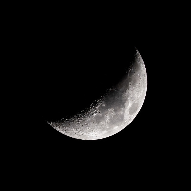 """Waxing Crescent Moon, 31% visible."" stock image"