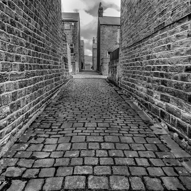 """""""Stone Cobbles in Passage. Silsden, Cobbydale, Yorkshire, England. Photographed 18th February 2021. Monochrome."""" stock image"""