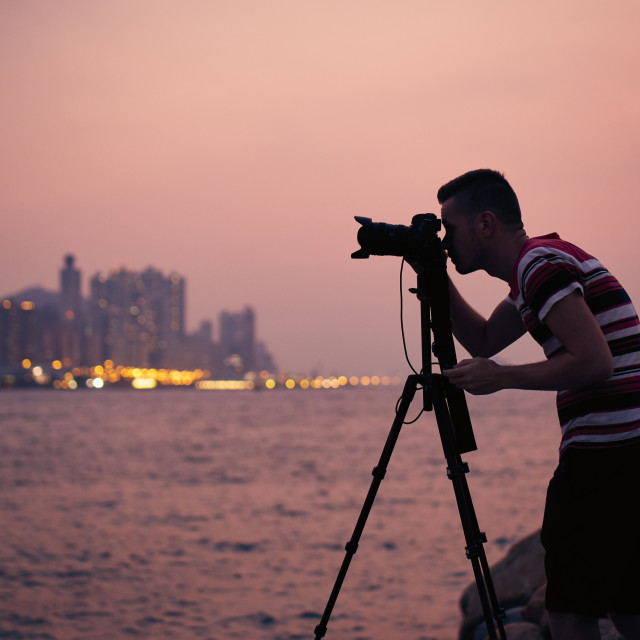 """""""Silhouette of photographer with tripod"""" stock image"""