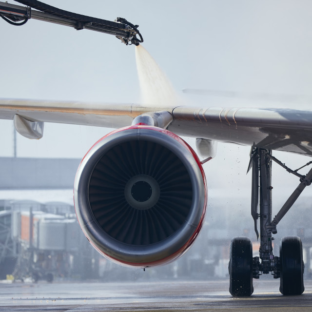 """""""Deicing of airplane before flight"""" stock image"""
