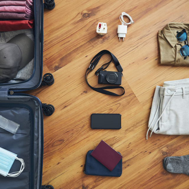 """""""Packing suitcase for travel in new normal"""" stock image"""
