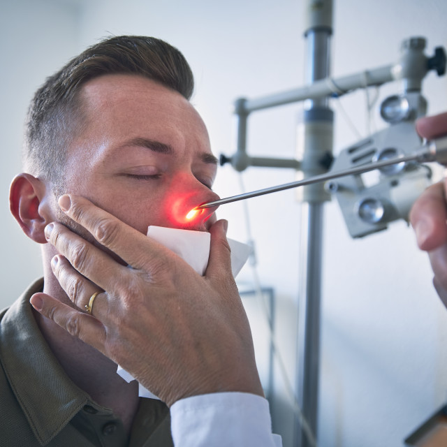 """""""Doctor doing nose examination of young patient"""" stock image"""