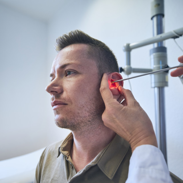 """""""Doctor doing ear examination of young patient"""" stock image"""