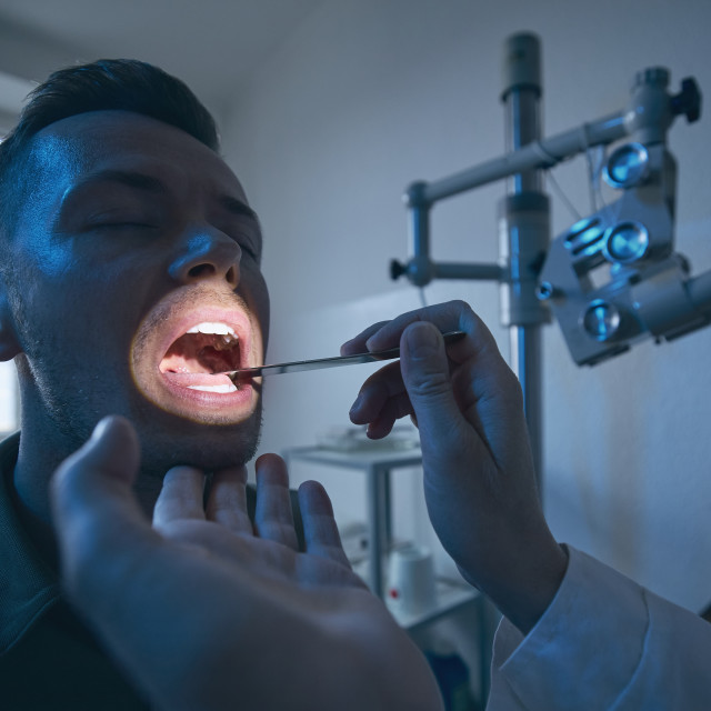 """""""Doctor doing throat examination of young patient"""" stock image"""
