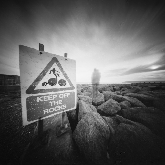 """Keep off the rocks - Pinhole photo."" stock image"