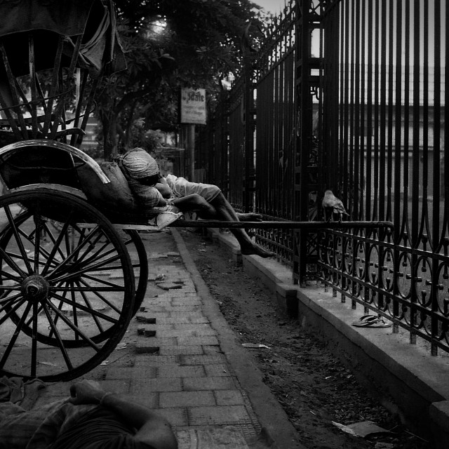 """""""Sleeping Rickshaw Puller"""" stock image"""
