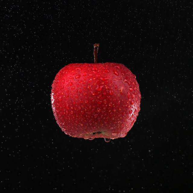 """""""Delicious juicy red apple on a black background for everyone who likes fruits"""" stock image"""