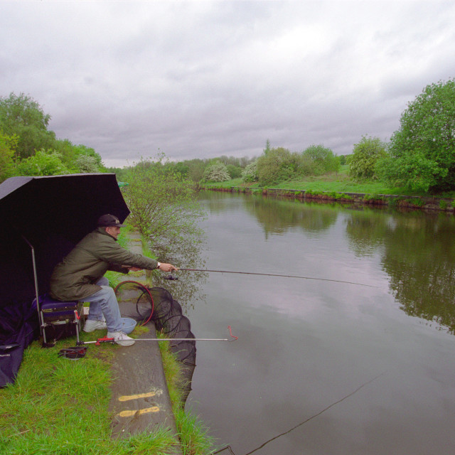 """""""Man fishing on canal"""" stock image"""