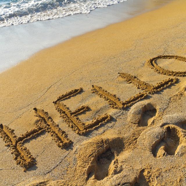 """Hello on a golden sandy beach"" stock image"