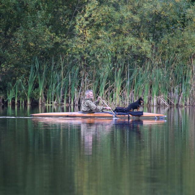 """Canoeing on Escomb Lake"" stock image"