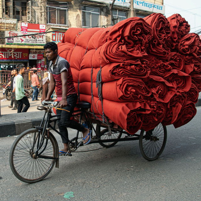 """""""RED ROLLS OF FABRIC"""" stock image"""