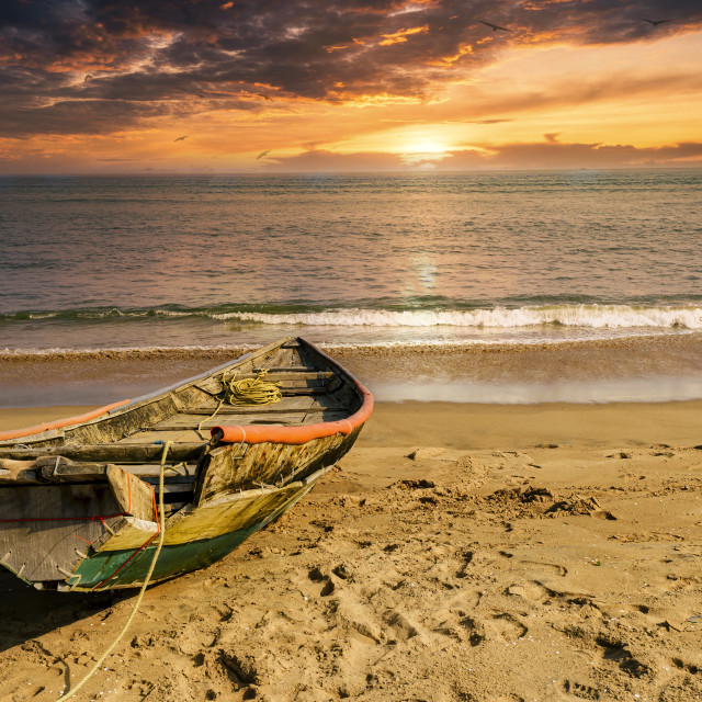"""""""Fishingboat moored on the seabeach with copy space"""" stock image"""
