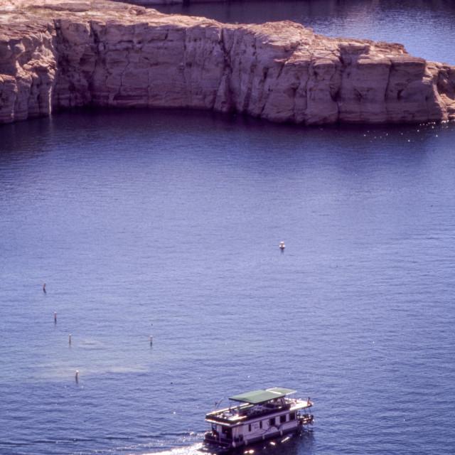 """Lake Powell with houseboat."" stock image"