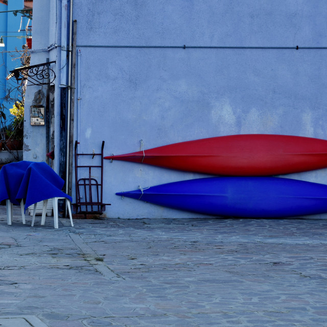 """""""Two canoes on a wall"""" stock image"""