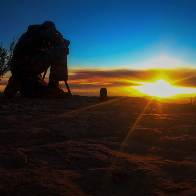 """""""canon-camera-man-taking-sunset-picture"""" stock image"""