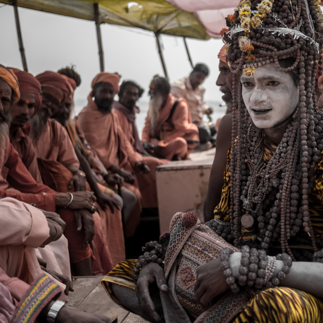"""Sadhu and pilgrims on a boat"" stock image"