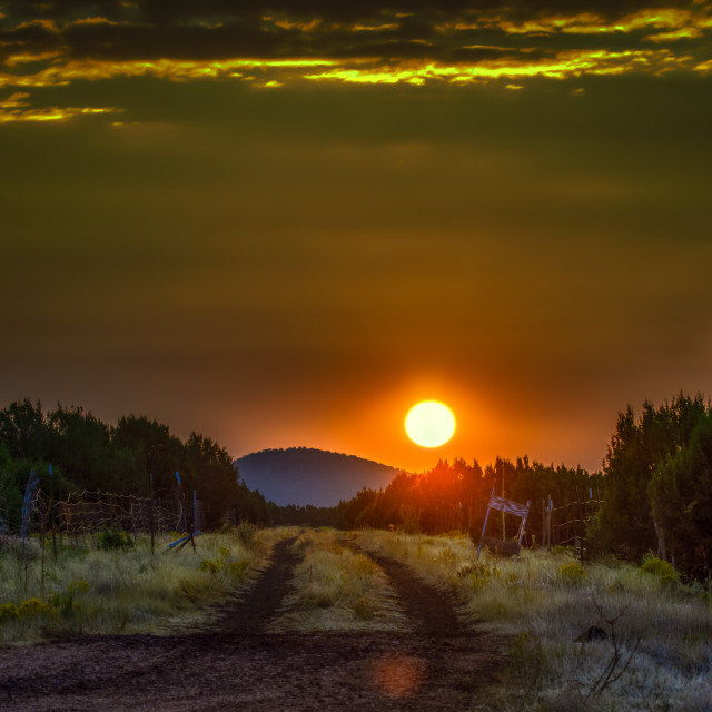 """dirt road-sunset-mountain-landscape"" stock image"