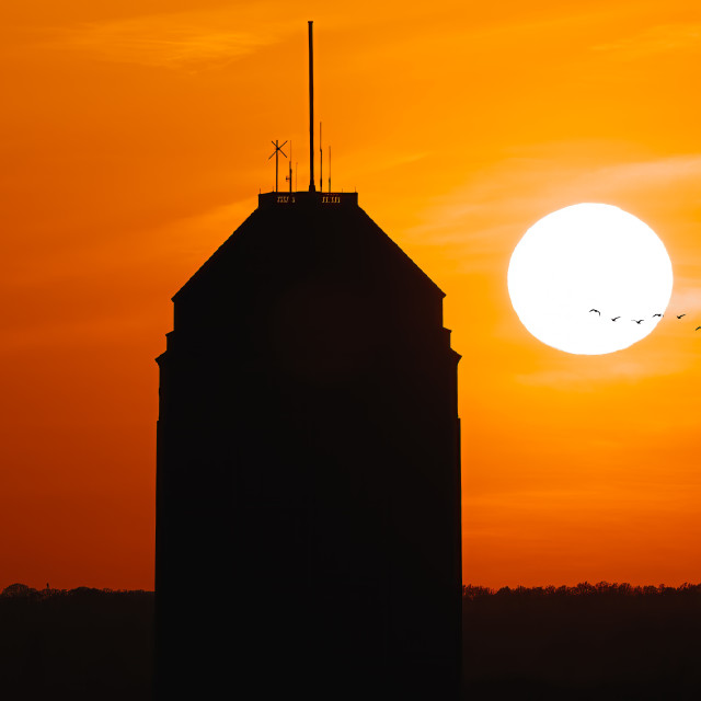 """""""Golden hour sunset and silhouette of Cambridge University Library."""" stock image"""