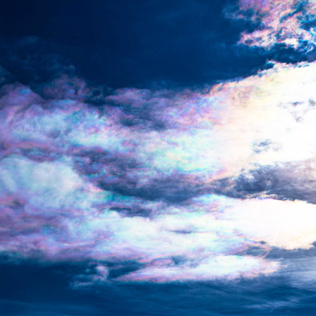 """""""Iridescent Clouds appearing to trail the sun"""" stock image"""