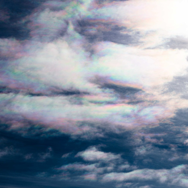 """""""Iridescent Clouds appearing like a giant bird in the sky"""" stock image"""