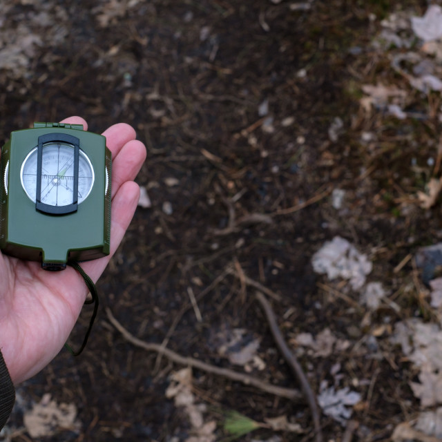 """""""Closed prismatic compass ready to use"""" stock image"""