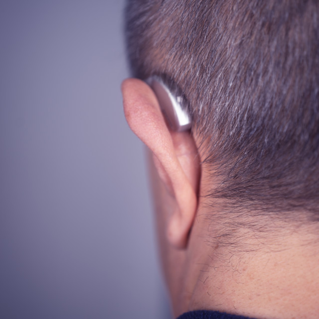 """Hearing aid ear of man"" stock image"