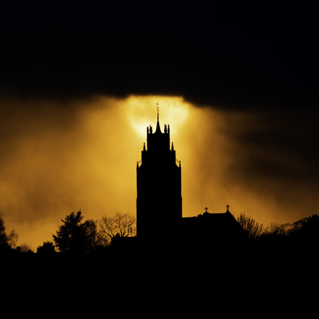 """""""Sunset behind St Andrew's Church tower, (The Pepperpot)"""" stock image"""