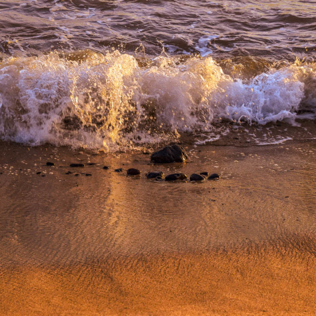 """""""The Shimmering Of The Waves At Sunset"""" stock image"""