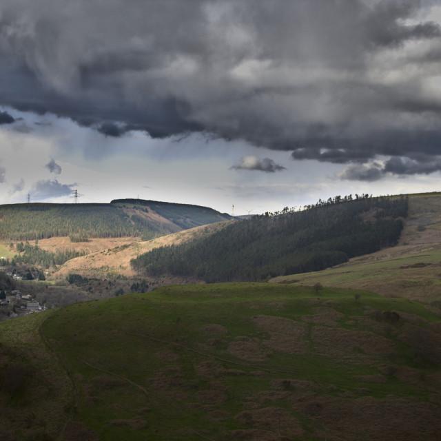 """Pen-Y-Castell Hillfort under dark skies"" stock image"