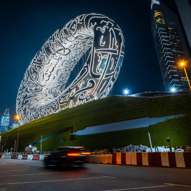 """""""The Museum of The Future in Dubai downtown built for EXPO 2020 scheduled to be held in 2021 in the United Arab Emirates illuminated at night"""" stock image"""