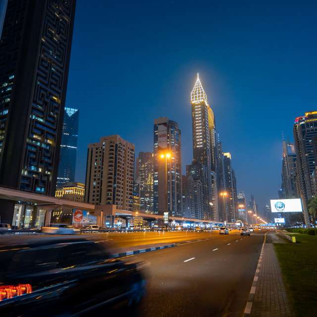 """""""Downtown Dubai modern skyline above Sheikh Zayed road on of the busiest highways in the UAE at blue hour"""" stock image"""