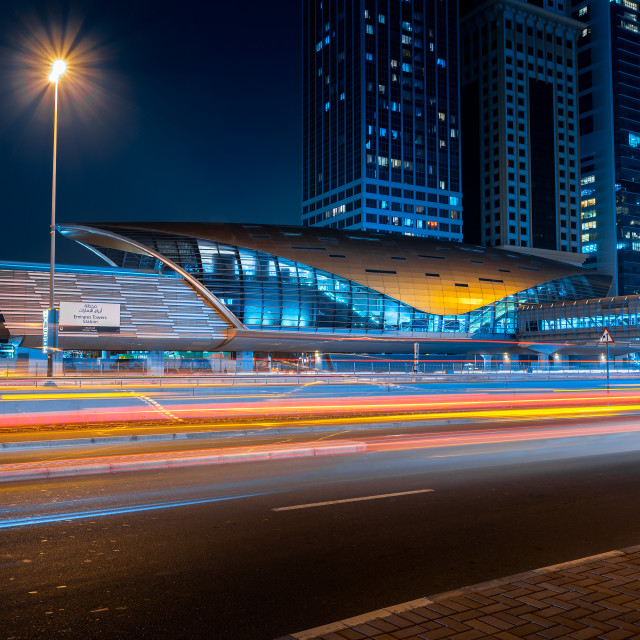 """""""Dubai metro station at Downtown Dubai across Sheikh Zayed road, one of the busiest highways in the UAE at blue hour"""" stock image"""