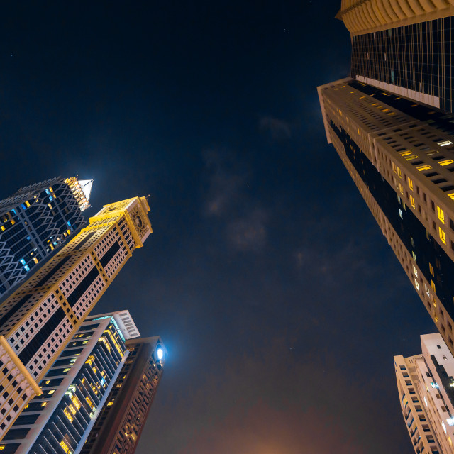 """""""High rise skyscrapers above downtown Dubai making landmark skyline view above Sheikh Zayed road in the UAE at blue hour"""" stock image"""