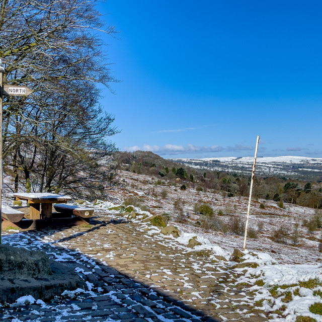 """View from White Wells, Rombalds Moor, Ilkley, Yorkshire, England, UK. Snow on the ground. Photographed 11th April 2021."" stock image"
